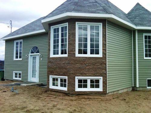 Дом с комбинированной отделкой сайдингом