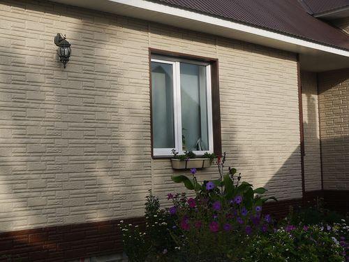 Виниловый сайдинг под камень: фото фасадов домов
